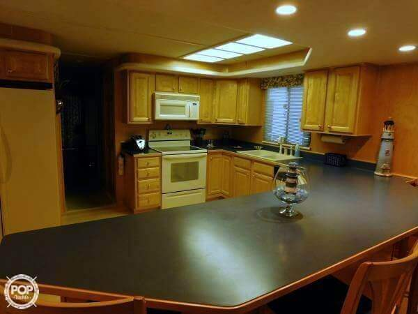 Open Kitchen With Huge Counter To Spread Your Meals Around