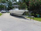 2002 STAMAS 250 TARPON, 2005 MAGIC TILT DUAL AXLE ALUMINUM TRAILER