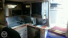 Galley With Stove, Microwave, Refrig & Sink - Wood Floor In Galley Area