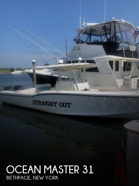 2002 Ocean Master boat for sale, model of the boat is 31 Super Center Console & Image # 1 of 33
