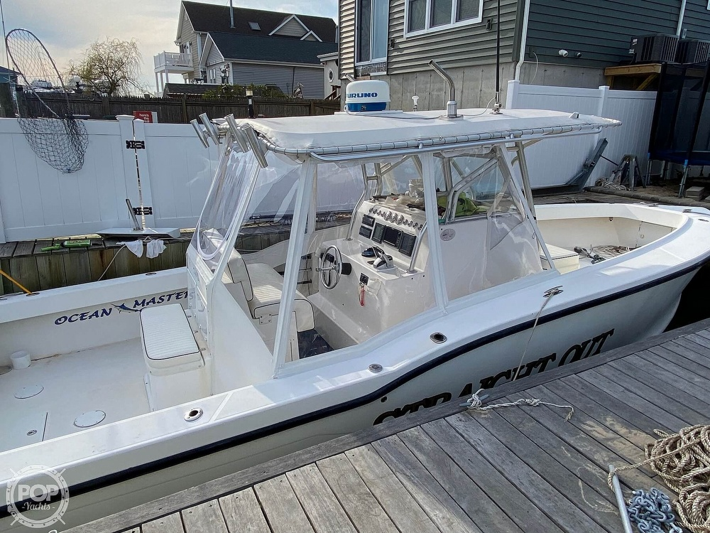 2002 Ocean Master boat for sale, model of the boat is 31 Super Center Console & Image # 2 of 33