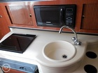 Full Galley With Microwave, Stove, Sink & Faucet & Refrigerator
