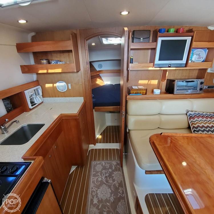 2005 Mainship boat for sale, model of the boat is 34 Pilot Sedan Rum Runner II & Image # 3 of 40