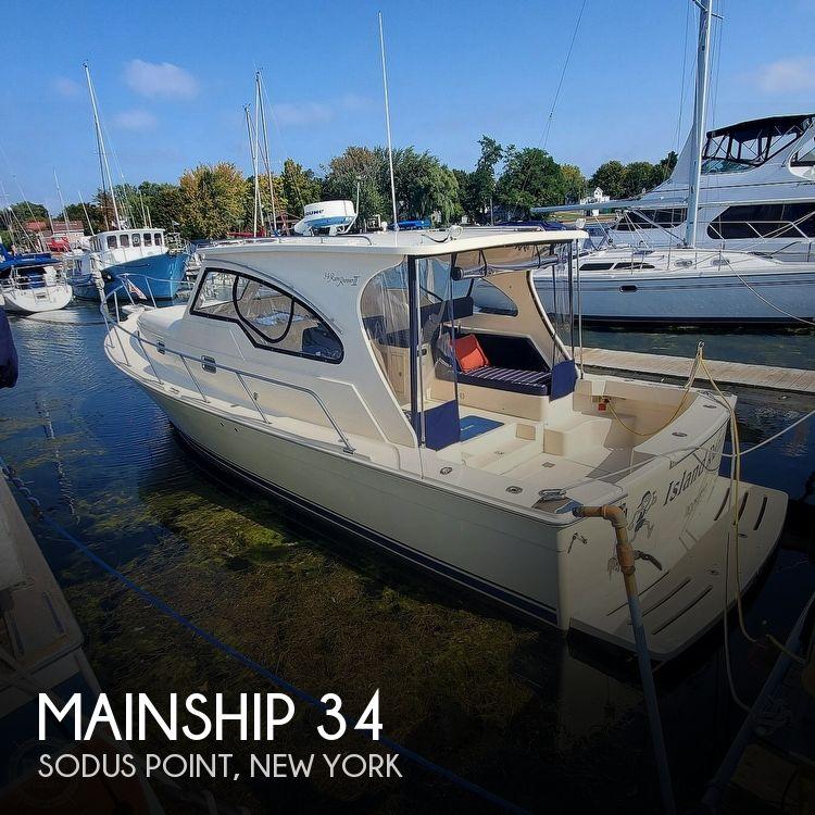 2005 Mainship boat for sale, model of the boat is 34 Pilot Sedan Rum Runner II & Image # 1 of 40