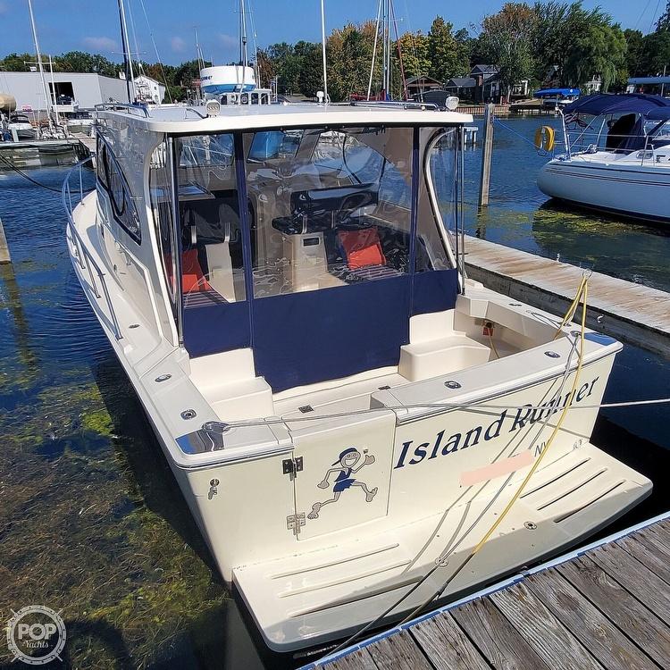 2005 Mainship boat for sale, model of the boat is 34 Pilot Sedan Rum Runner II & Image # 2 of 40