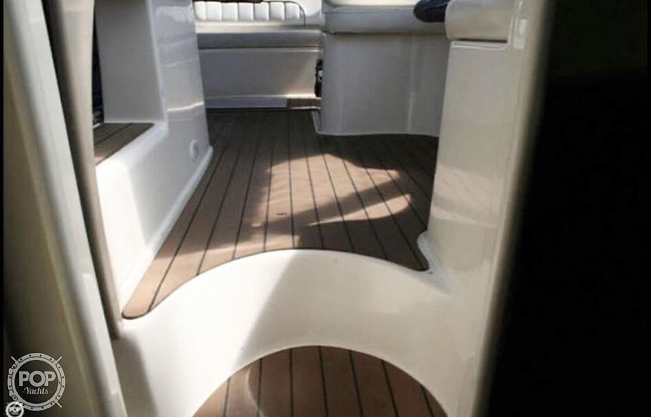 2003 Rinker boat for sale, model of the boat is Fiesta Vee 312 & Image # 2 of 7