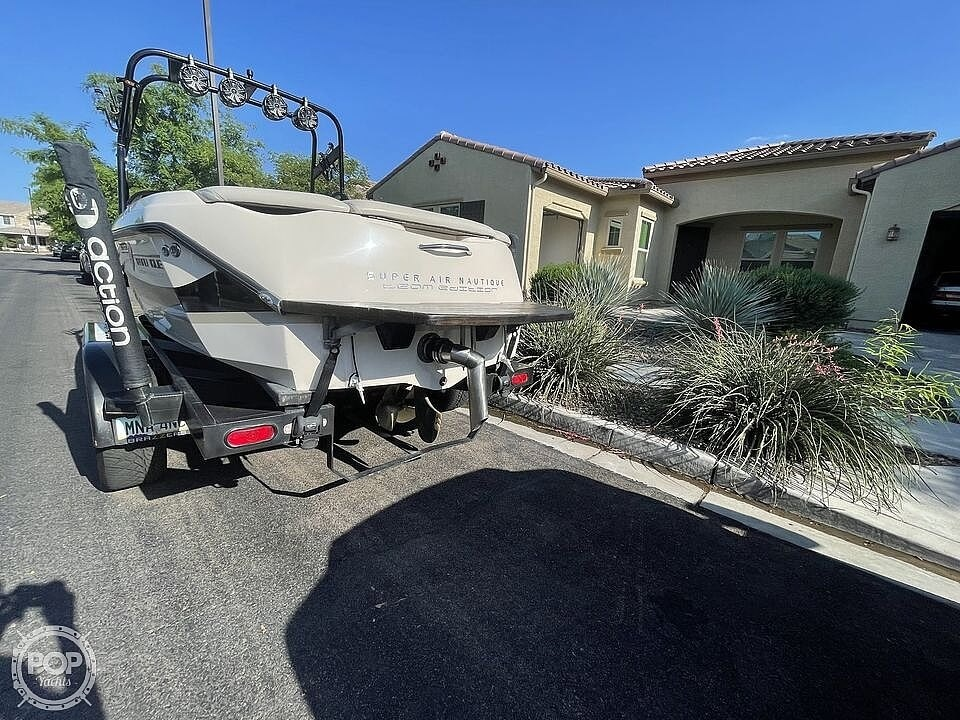 2002 Correct Craft boat for sale, model of the boat is Super Air Nautique 210 Team Edition & Image # 4 of 40