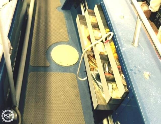4 TACKLE DRAWERS BOTH SIDES OF THE BOAT
