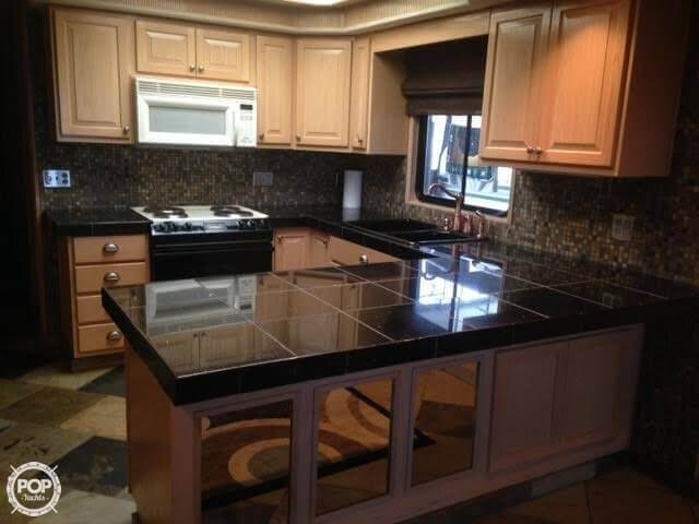 Beautifully Remodeled Galley - (note The Mirrors On Bottom Of Cabinets.)