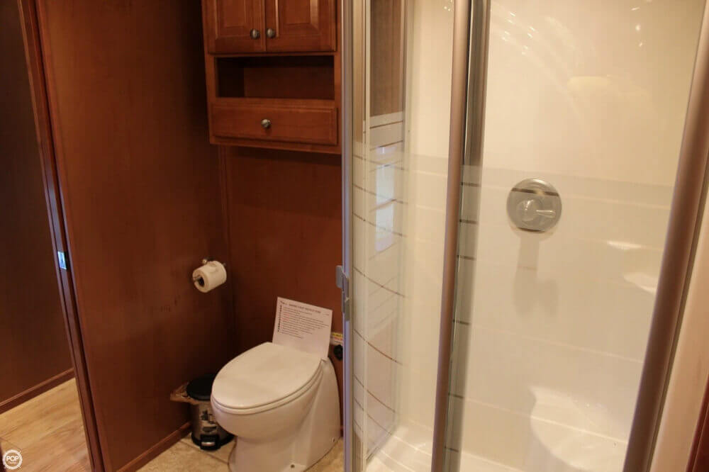 Large Tall Toilets And Sliding Shower Doors Maximizing Space And Comfort.